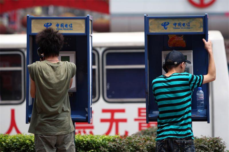 """5.17世界电信日_""""5.17世界电信日"""":街头逐渐消失的磁卡电话 你还记得吗?"""