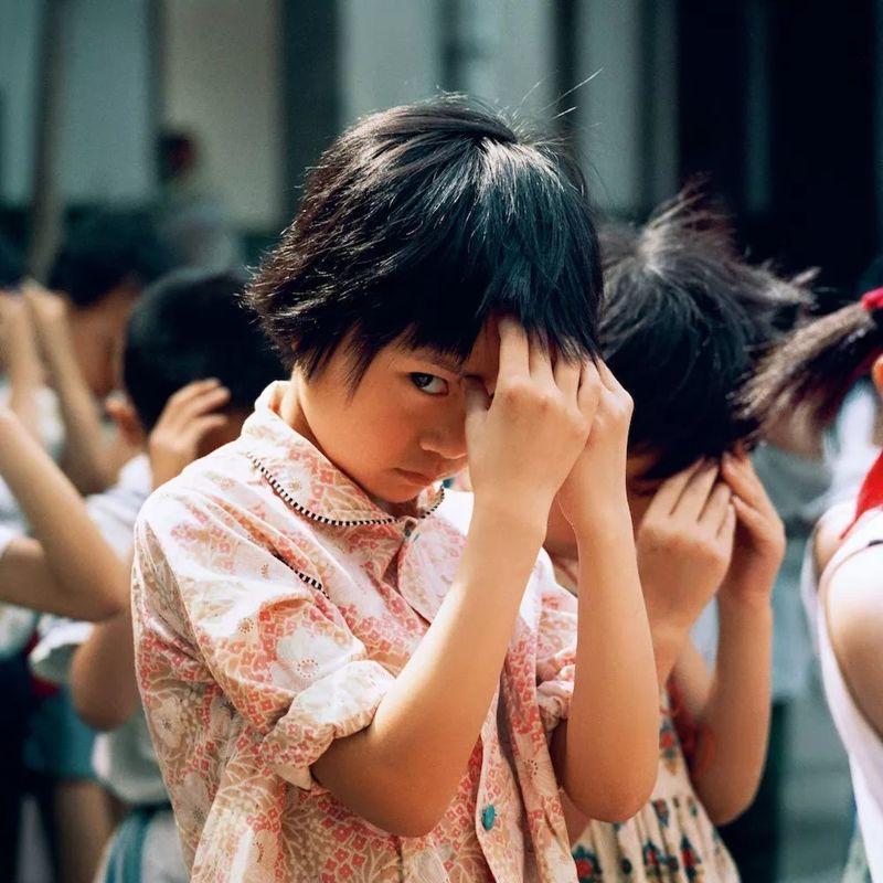 """一个日本摄影师""""偷拍""""的中国中国孩子"""